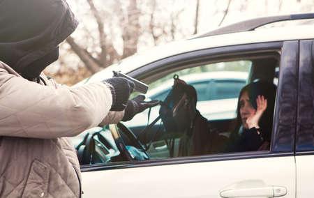 robber with a gun robbing a girl