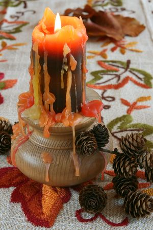 the lumen: Still-life with candlestick and leafs