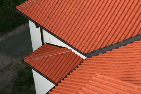 roofing membrane: The red tiled roof top Stock Photo