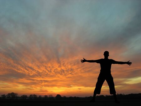 Silhouette of a man in sunset landscape Stock Photo - 5484551