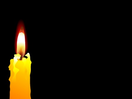 igniting: Yellow candle on the black background