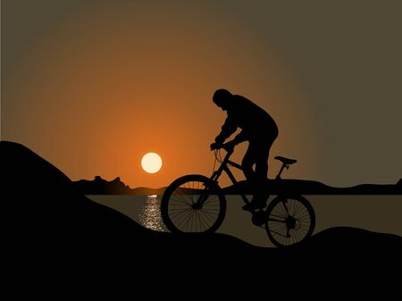 extremesport: Cyclist by the sea in the sunset