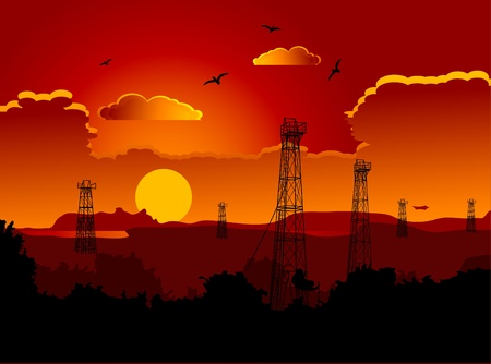 torres petroleras: Oil rigs in the sunset