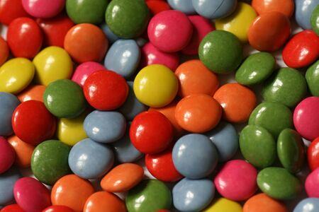 ms: Background with colored chocolate candies Stock Photo