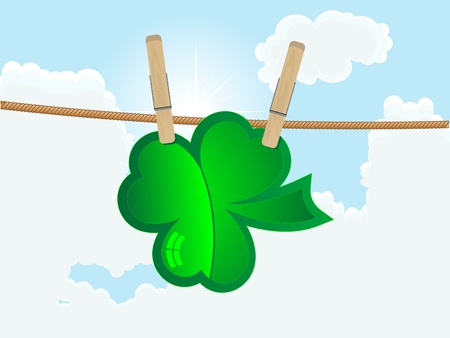 Green clover hanging on the rope against cloudy sky Stock Vector - 12802067