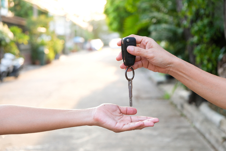 Young businessmen submit car keys to