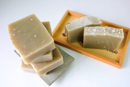 Natural oatmeal soap is placed on a white background. 스톡 콘텐츠