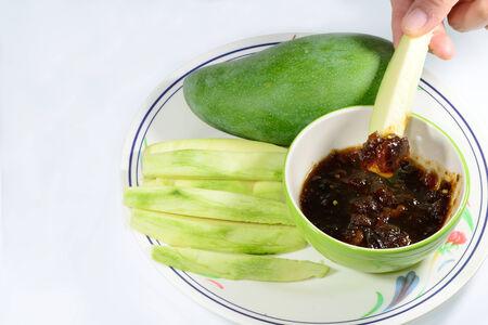 mango fish: Mango With Sweet Fish Sauce on white background