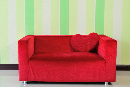Sofa red heart-shaped pillow photo