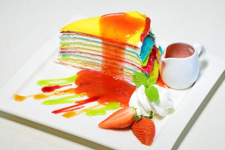 Rainbow crepe cake with strawberry jam photo