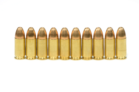 A group of 9mm bullets for a a gun isolated on a white background  photo