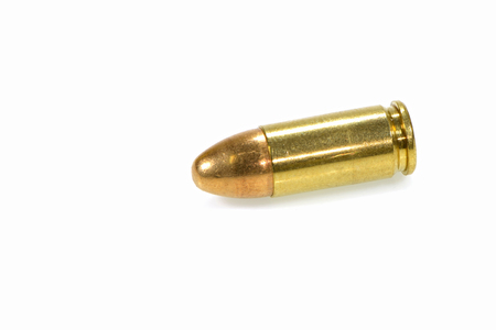 9mm bullet for a gun isolated on a white background photo