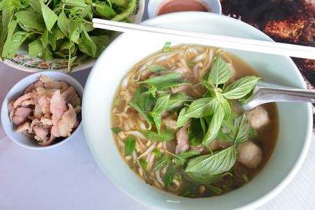 pork noodle with soup and vegetables in thailand  photo