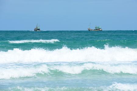 profundity: Trawler fishing boat working in open waters