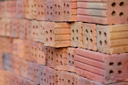 red clay: A stack of red clay bricks