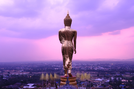 a righteous person: Buddha statue standing at Wat Phra That Khao Noi, Nan ,thailand Stock Photo