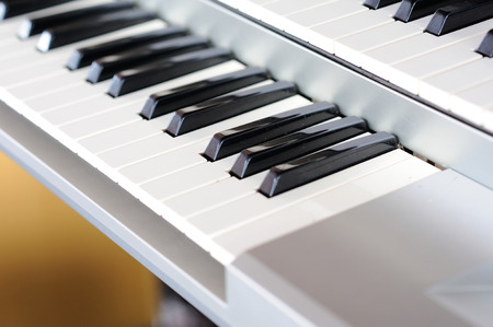 Piano keys side view with shallow depth of field  photo