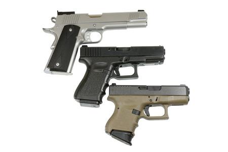cocked: three pistols on white background