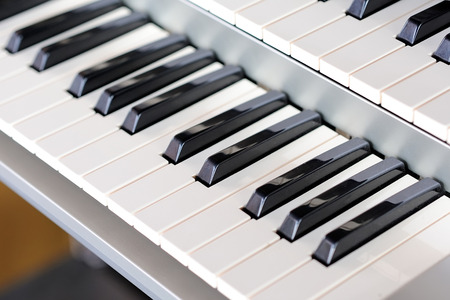 lacquered: Piano keys side view with shallow depth of field