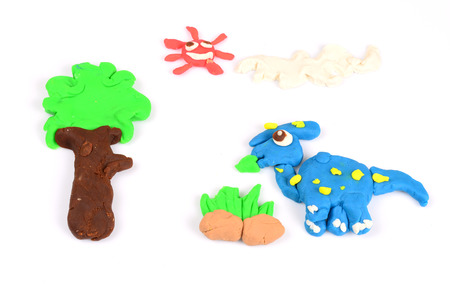 playdoh: The dinosaurs from colorful clay dough Stock Photo