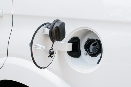fueling pump: cars fuel cap openned ready to fill up petrol Stock Photo