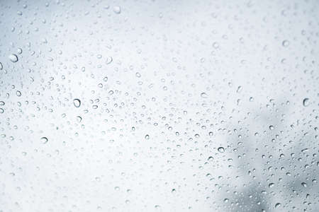 Rain water drops on a glass , Abstract Backdrop vintage style.