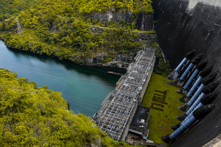 Bhumibol Dam, Concrete Arch Dam on Ping River.Hydroelectric dam Concrete structure, River in the forest. Stock Photo