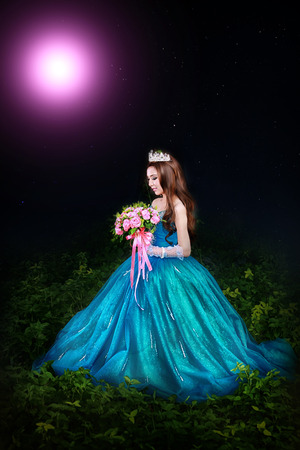 [Cinderella ] A beautiful young girl like Cinderella is walking in the garden. Stock Photo