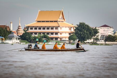 OCT 10: 2017 When the End of Buddhist Lent Day come, The Buddhist give food offerings to Buddhist monks,The Chao Phraya River Waterfront community in Thailand.