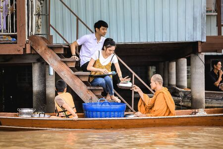 OCT 10: 2017  OCT 10: 2017  When the End of Buddhist Lent Day come,In Thailand, The Buddhist give food offerings to Buddhist monks In case of Waterfront community especially on the Chao Phraya River Waterfront community,which is the main river of the coun