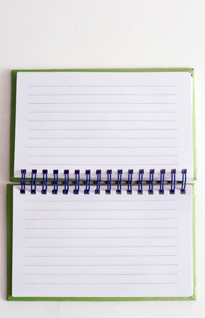 Spiral bound note pad on white background photo