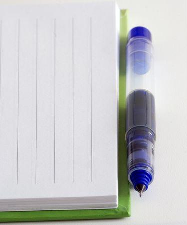 Closeup note pad and pen photo