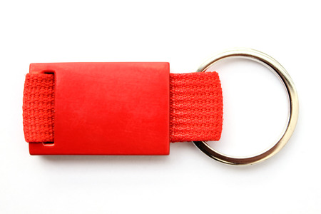 trinket: Red keychain isolated to put a trademark