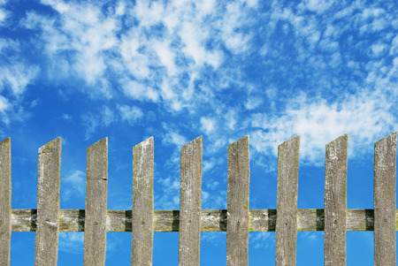 old wooden fence with cloudy sky photo