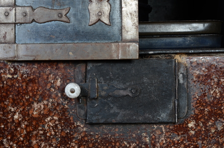 tiled stove: door to furnace Stock Photo