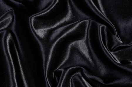 luxury background: black silk satin background