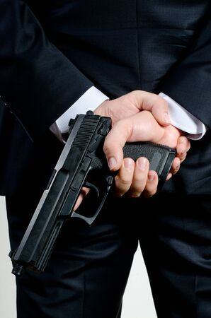 glock: man in suit holding gun