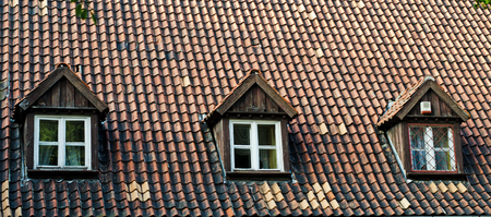 old roof with attic windows