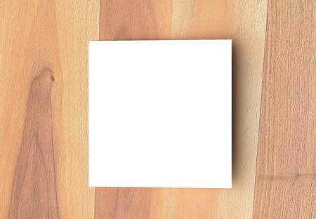 Bifold square brochure mock up on wooden background. 3D illustrating