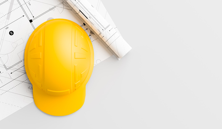 Yellow safety helmet on wooden table with blueprints. Safety helmet for labourers and earth moving operators 3D illustration. Stock Illustration - 124431072