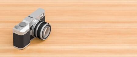 Retro looking digital camera isolated on wooden background with copy space. 3D illustration Stock fotó