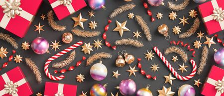 Merry Christmas and happy new year background. Christmas ornaments and gift boxes on black background. 3D illustration.