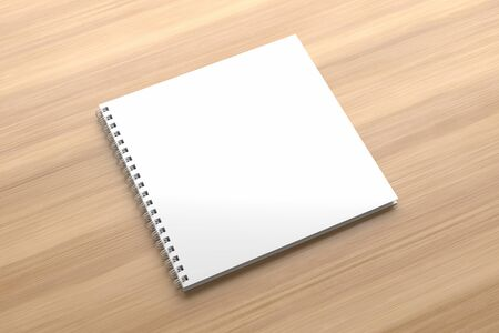 Realistic spiral binder square notebook mock up isolated on wooden background. 3D illustration