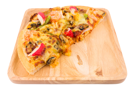 plage: Seafood pizza on wooden plage ,white isolated background with selective focus