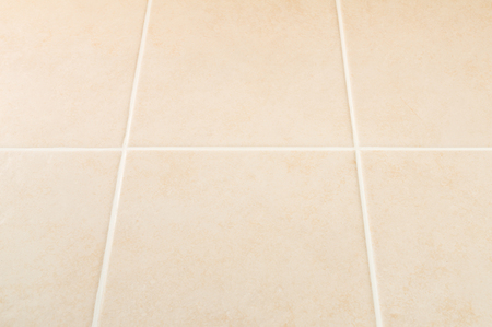 grout: Cream tile wall with white grout pattern, perspective view