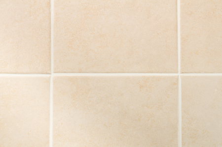 grout: Cream tile wall with white grout pattern, front view Stock Photo