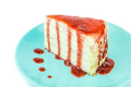 mille: Mille crepe cake with strawberry sauce on white background. Selective focus