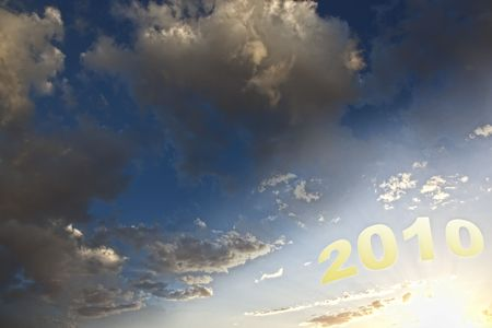 better days: Hopeful New Year 2010 with cloudy blue sky and sunrise Stock Photo