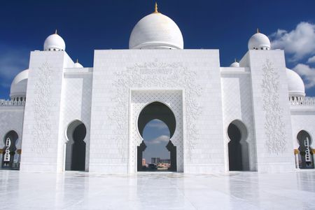 white mosque with cloudy blue sky in Abu Dhabi photo
