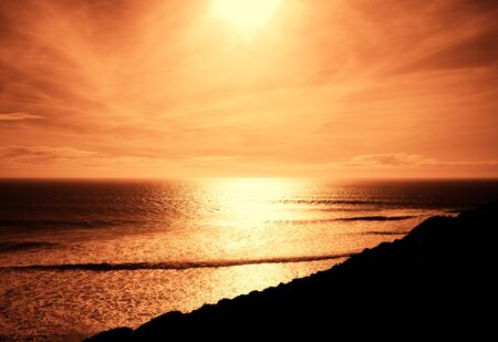 dark red evening light over sea.  photo